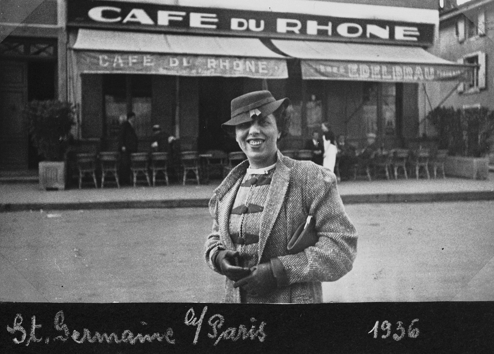 Kaethe Heksch Salomon, a German-Jewish woman, stands outside a cafe in Paris.