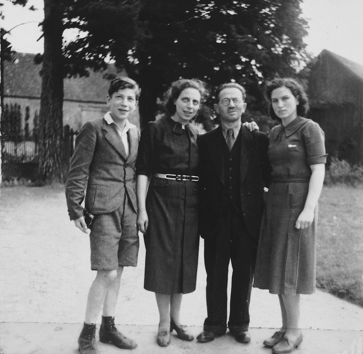Portrait of a German-Jewish refugee family in France.  Pictured from left to right are Erich, Marie, Sigmund and Lore Rothheimer.