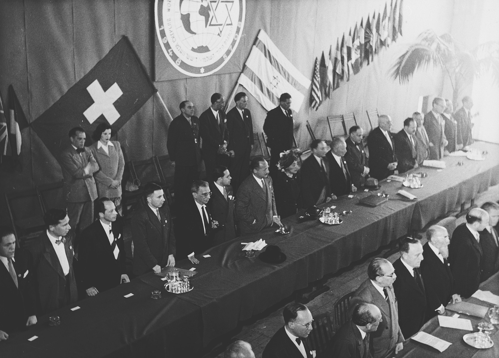 The Presidium at the opening session of the Assembly of the World Jewish Congress in Montreux, Switzerland.   Among those pictured is Gerhart Riegner (in the second row third from the left).