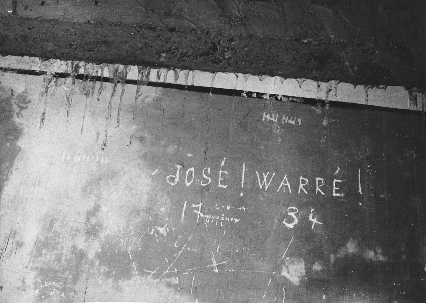 Prisoner name scratched on the wall of the Breendonck internment camp.