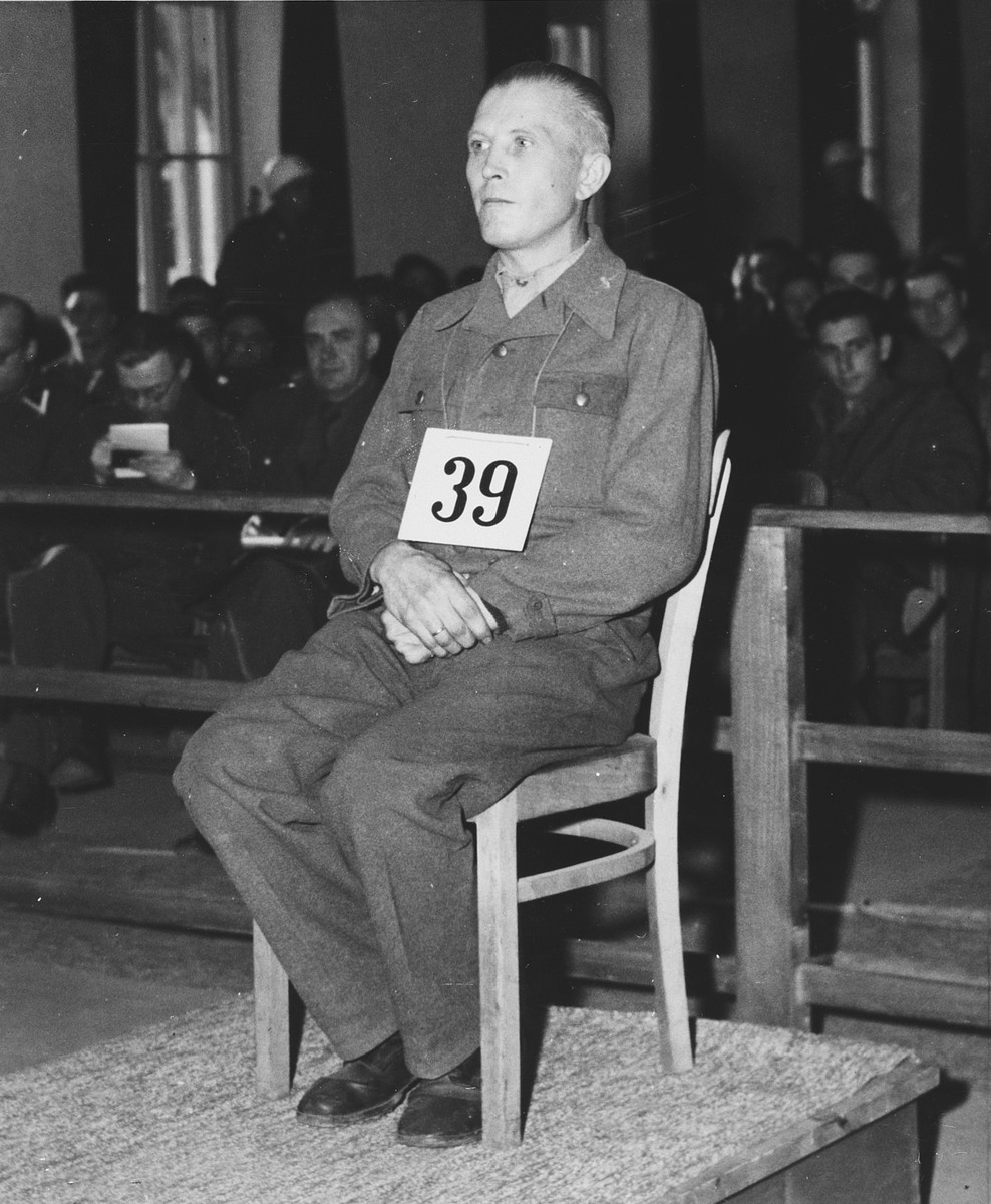 Defendant Otto Schulz sits at the dock during the Dachau war crimes trial.
