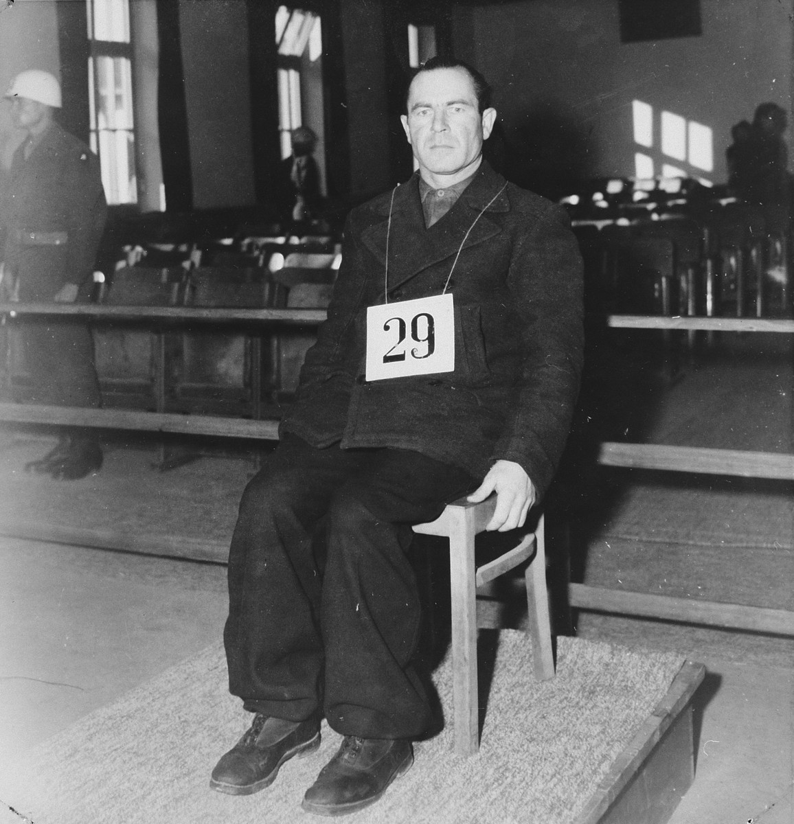 Defendant Sylvester Filleboeck sits at the dock during the Dachau war crimes trial.