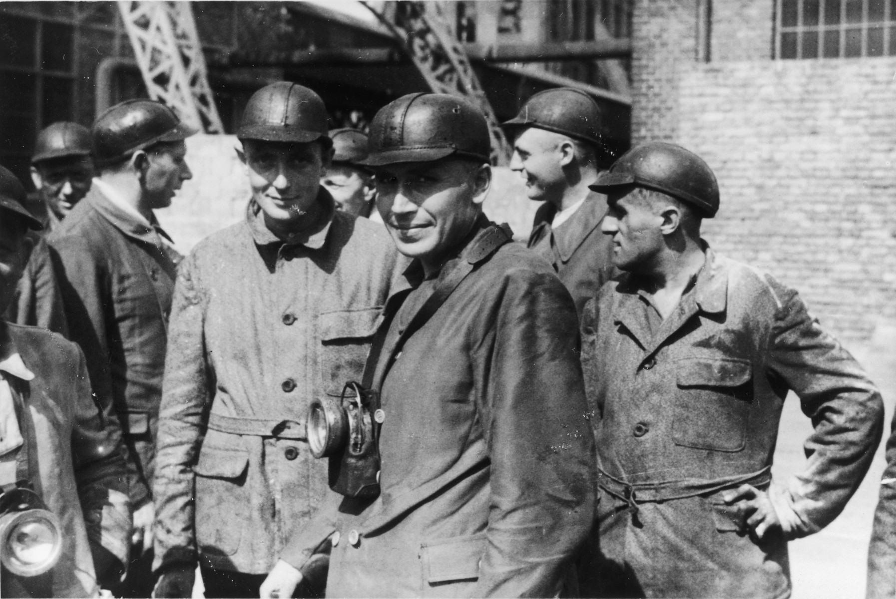 """A large group of SS officers visit a coal mine near Auschwitz.  The original caption reads """"Besichtigung eines Kohlenbergwerks."""" (visiting a coal mine)  Pictured from left to right are unknown, Dr. Heinz Baumkoetter, Gerhard Gerber, Dr. Enno Lolling (partially obscured) , Karl Hoecker (center), Dr. Eduard Wirths and Alfred Trzebinski."""