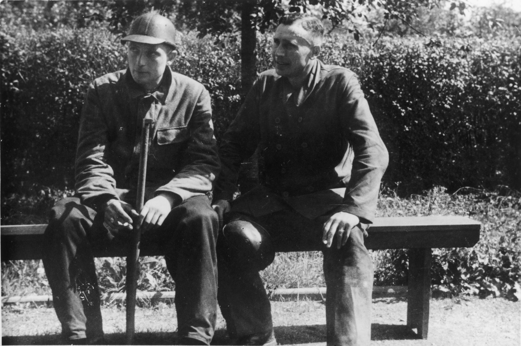 "Two SS officers visit a coal mine near Auschwitz.  The original caption reads ""Besichtigung eines Kohlenbergwerks."" (visiting a coal mine)  Pictured on the right is Karl Hoecker."