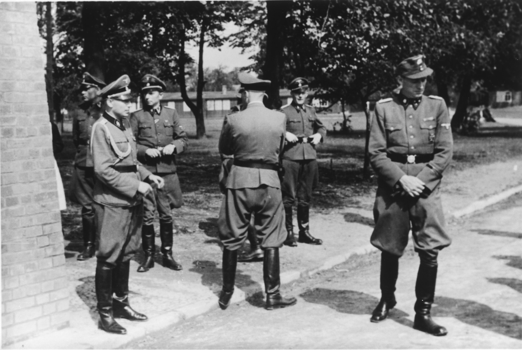 SS officers gather for the dedication ceremonies of the new SS hospital.  Pictured on the left is Karl Hoecker.  Behind him are Josef Kramer and Dr. Heinz Baumkoetter.
