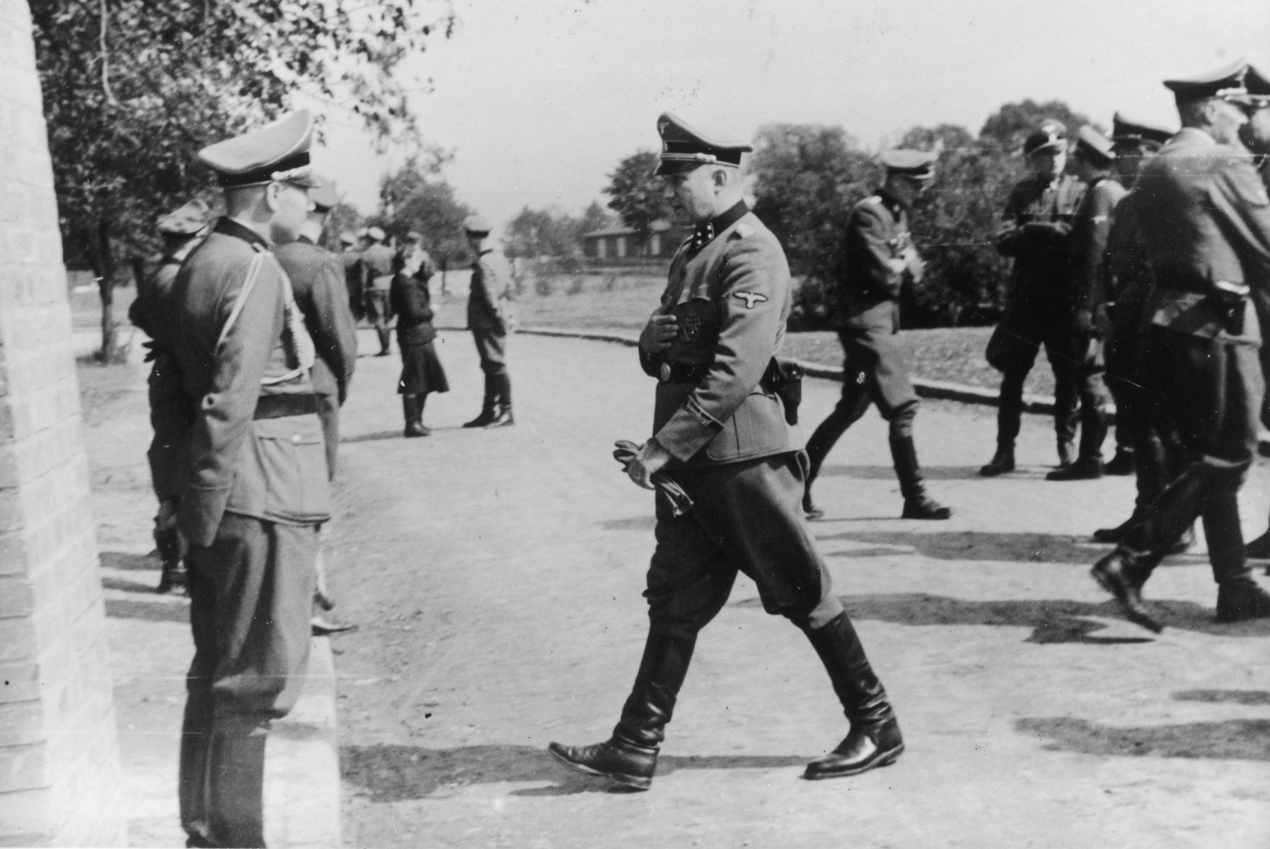 SS officers gather for the dedication ceremonies of the new SS hospital.  Commandant Richard Baer is walking towards Karl Hoecker (left).