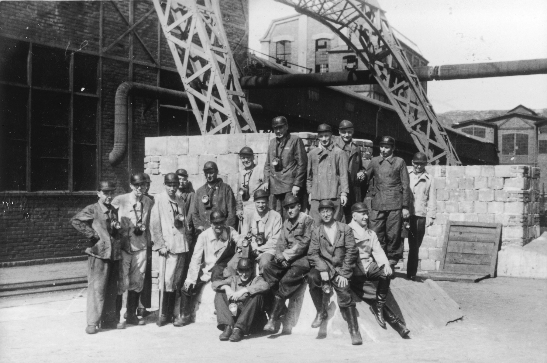 """A large group of SS medical personnel visit a coal mine near Auschwitz following the dedication of the SS Lazerette.  The original caption reads """"Besichtigung eines Kohlenbergwerks."""" (visiting a coal mine).  Seated in the front center is Gerhard Gerber.  Seated behind him (left to right) are Waldemar Wolter, possibly Weber, Alfred Trzebinski, Richard Trommer, and Fritz Klein.  Standing left to right are Willy Frank, unidentified, Wilhelm Witteler, unidentified, Max Blancke, Karl Hoecker, Enno Lolling, Eduard Wirths, Heinz Baumkoetter and Sohatz."""