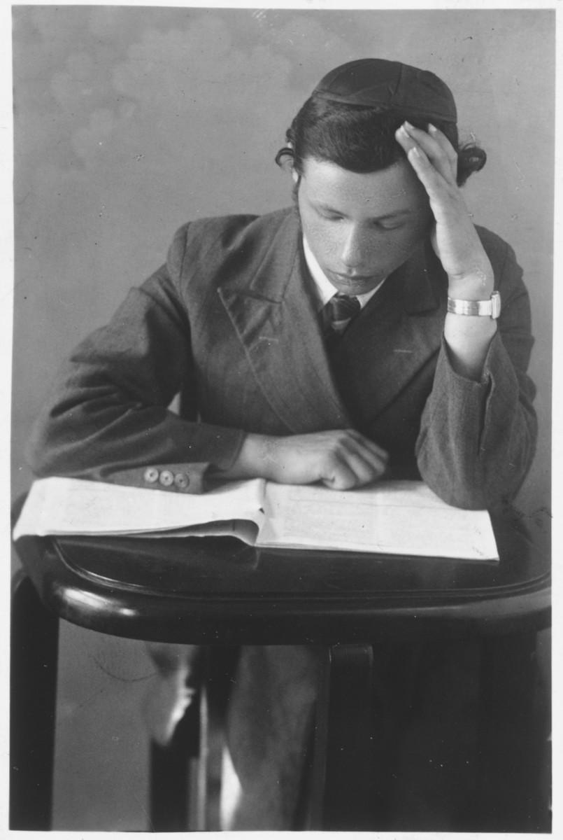Polish Jewish refugee Benjamin Gelbfisz studies a religious text.