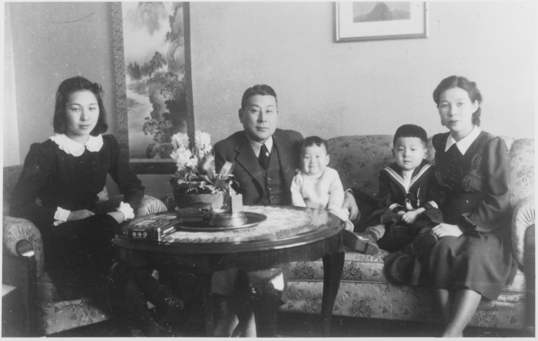 The Sugihara family sits in the living room of their residence in Kaunas shortly after their arrival.    Seated from left to right are: Setsuko Kikuchi (Yukiko's sister), Chiune Sugihara, Chiaki, Hiroki, and Yukiko Sugihara.
