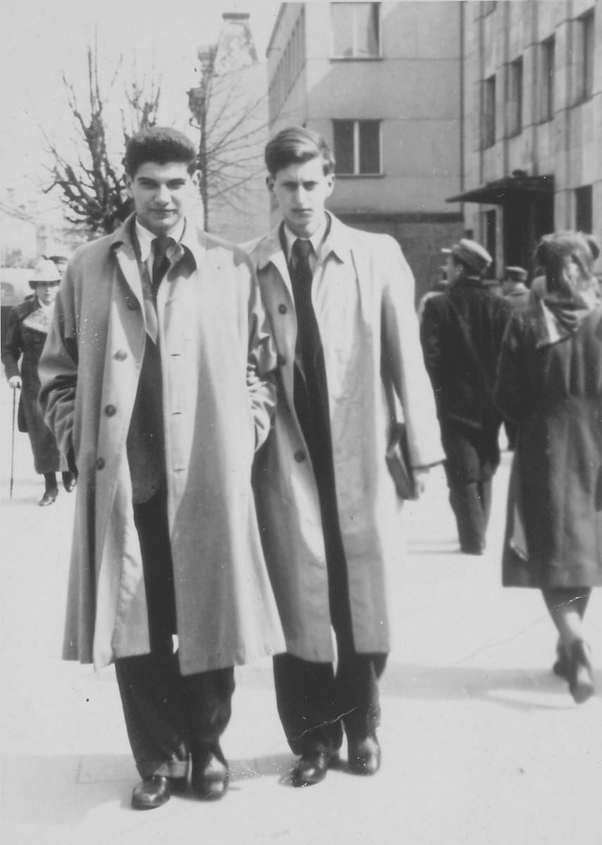"Jan Goldsztejn (left) and Markus Nowogrodzki (right) walk down a street in Vilna in 1940.   Jan Goldsztejn is the son of Bernard Goldsztejn, author of ""The Stars Bear Witness."""