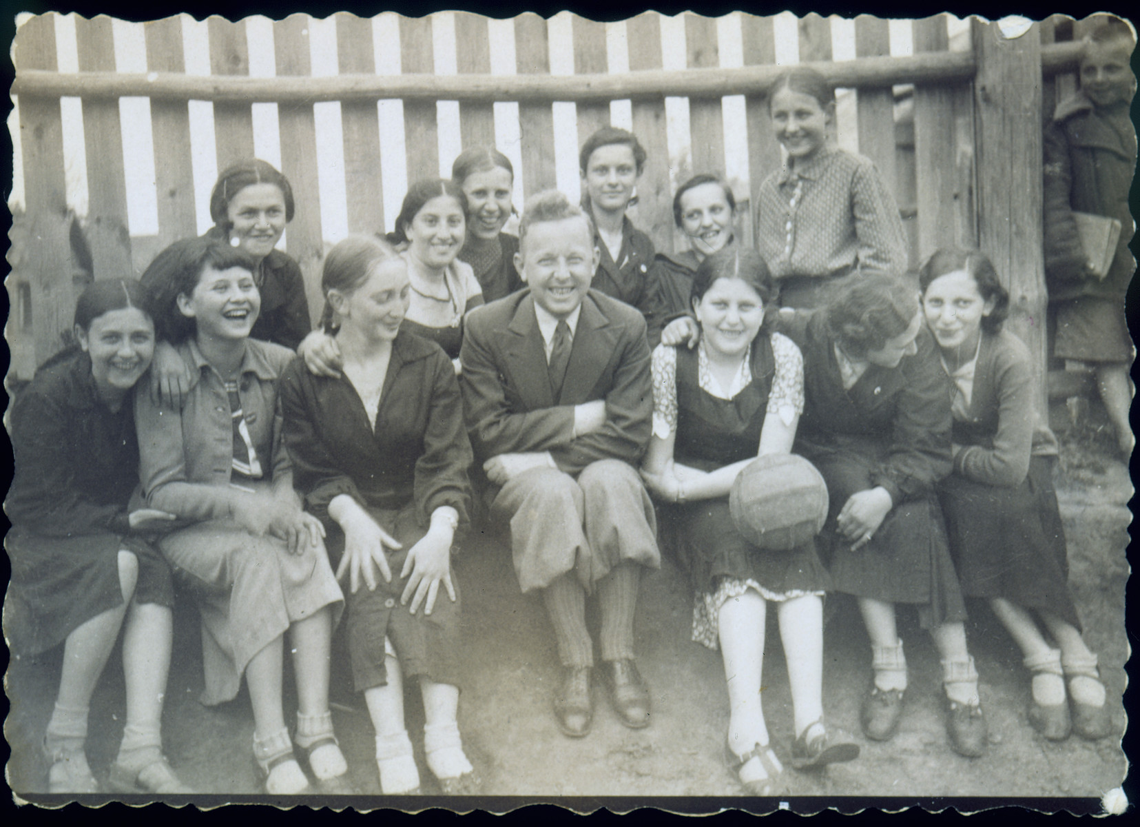 Group portrait of students in a physical education class at a Polish secondary school.    Among those pictured are: Chaya Szepsenwol (front row holding a volleyball); Fejga Szepsenwol (back row, second from the left); and Gala Rogovin (front row, third from the left).