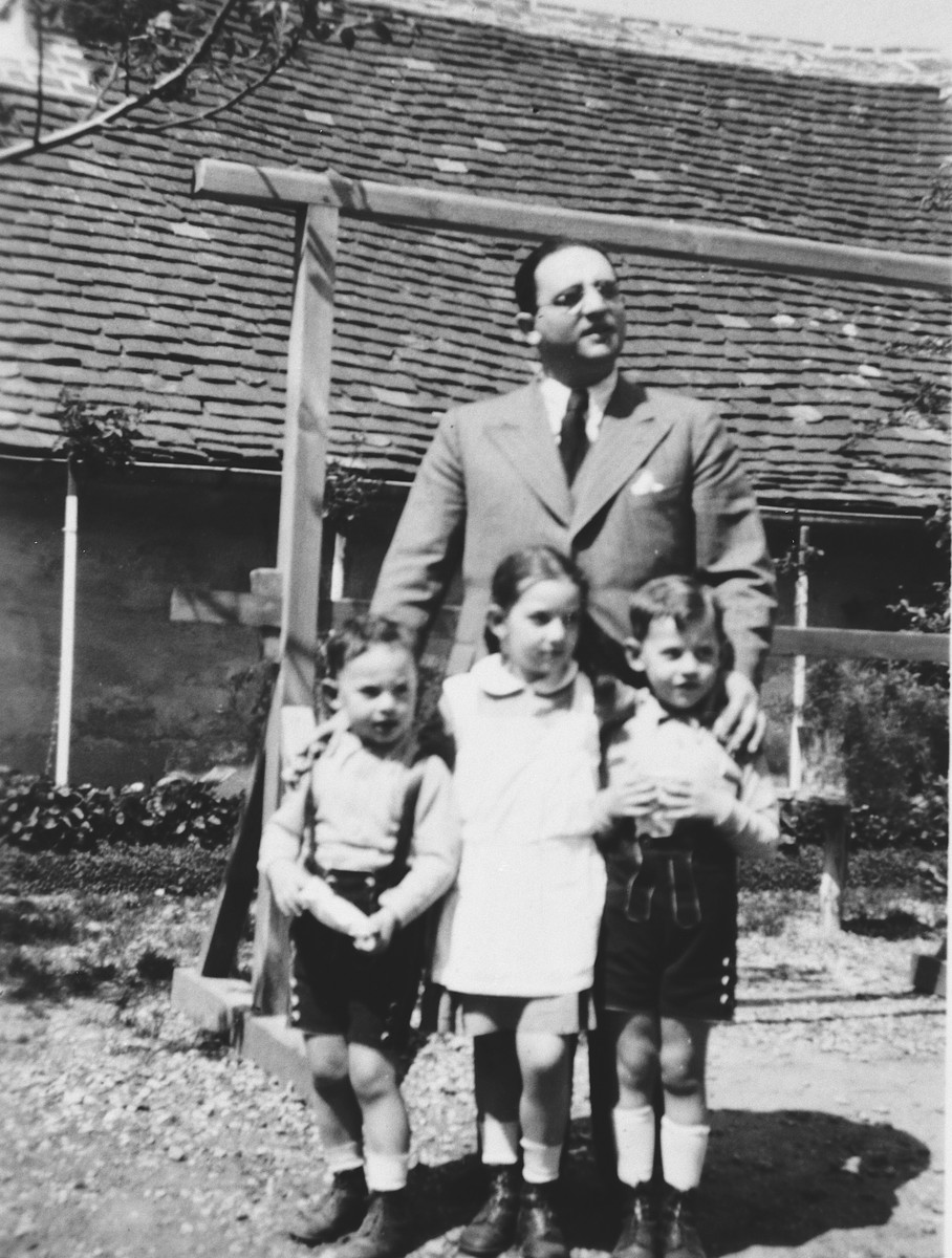 An Austrian-Jewish gentleman poses with his sister's children while visiting them in their home in Zalaegerszeg, Hungary.  Pictured are Wilhelm Basser and three of the children of Fella and Lajos Schoenfeld.