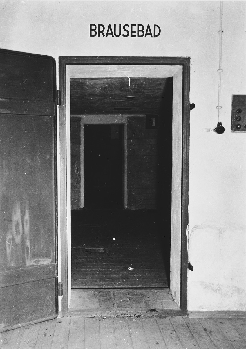 View of the door to the gas chamber in the Dachau concentration camp.  A sign above it identifies it as a shower.
