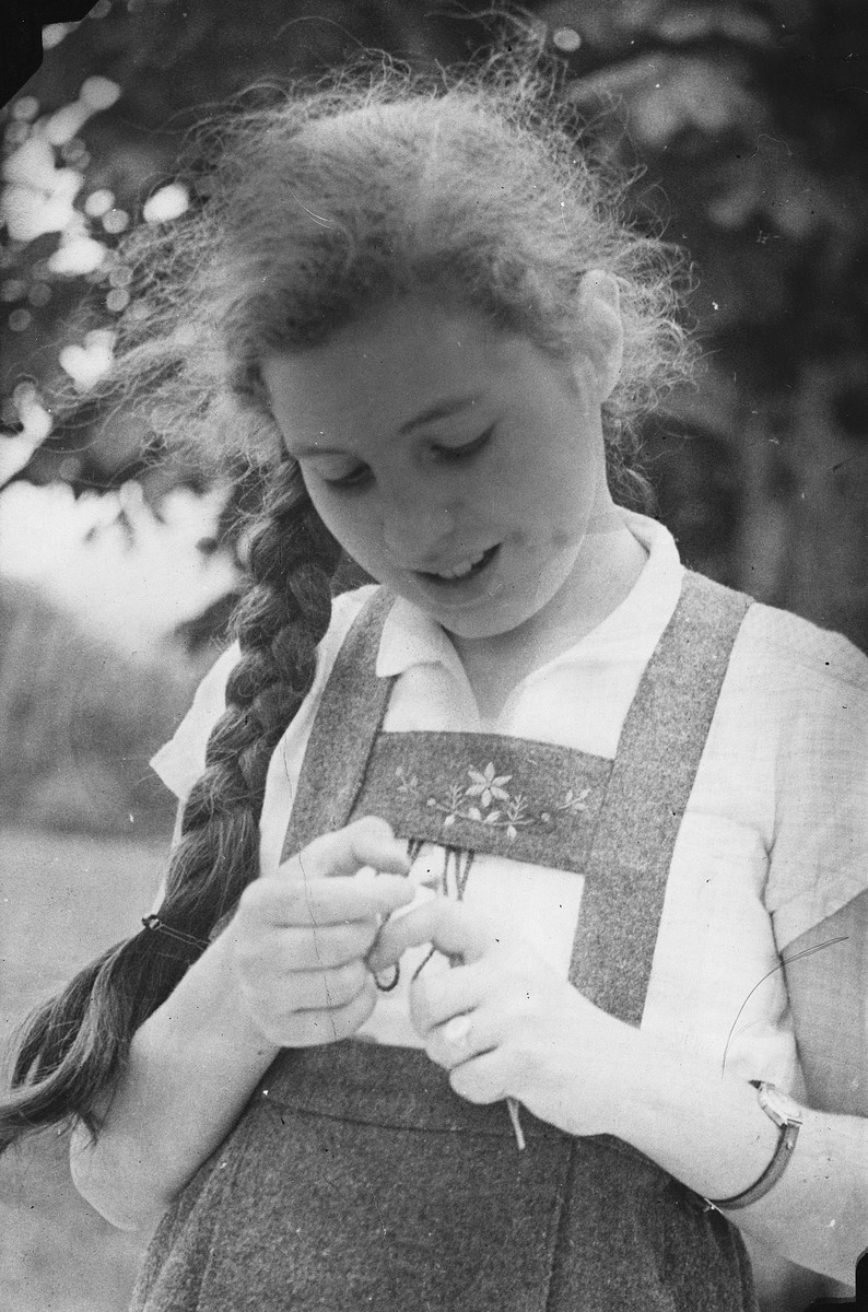 Close-up portrait of an Austrian-Jewish girl with a long braid.  Pictured is Susi Popper.
