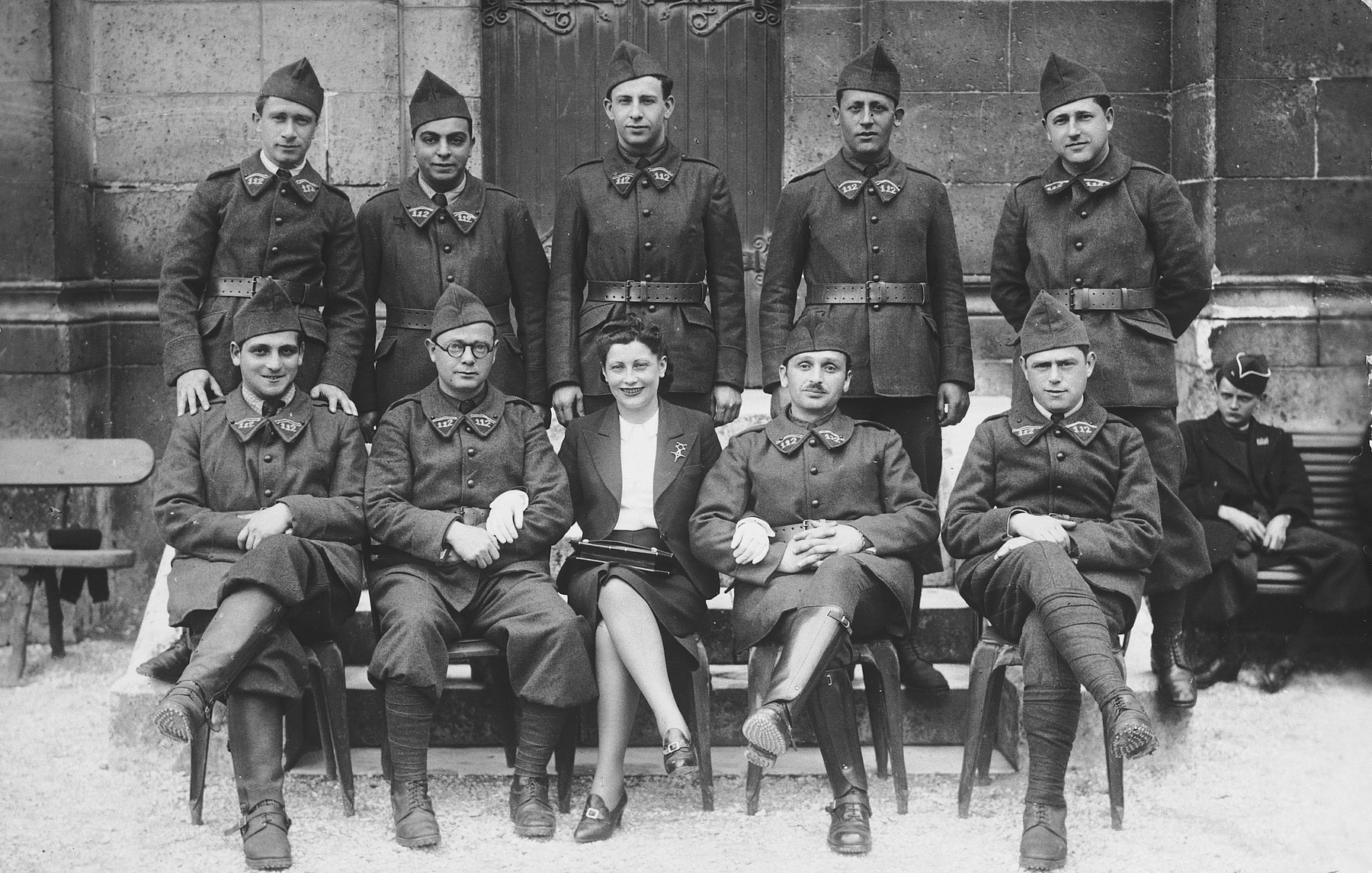 Group portrait of French soldiers shortly after the German invasion.  Among those pictured is Mattieu Findling (first row, far right), a foreign born Jew in the French army.