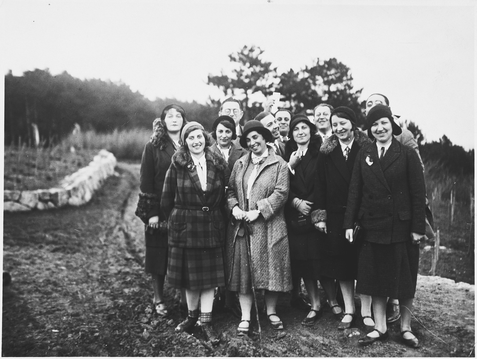 A group of Austrian-Jewish friends poses together during a weekly Sunday excursion to the parks.  Among those pictured are Wilhelm and Irene Basser.