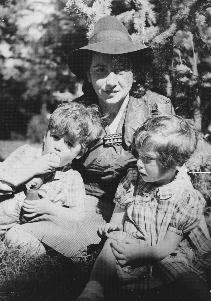 A Jewish woman visits her two children in the Limoges children's home, la Pouponniere, shortly before she removed them from the home to go into hiding.  Pictured are Sabina Findling and her two children.