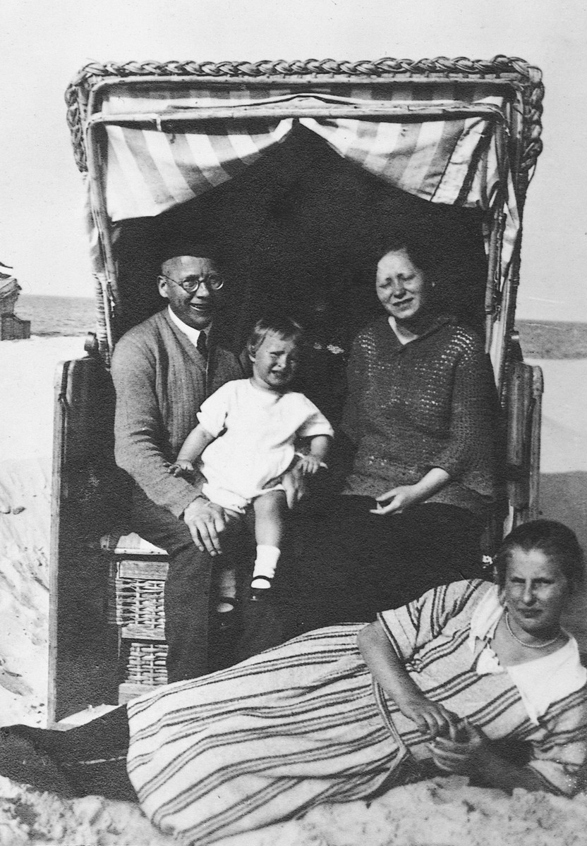 An intermarried German-Jewish family rests in their cabana on a beach on the Baltic Sea.  Pictured are Franz John, his daughter Eva and sister-in-law Regina (Rina) Bluth.