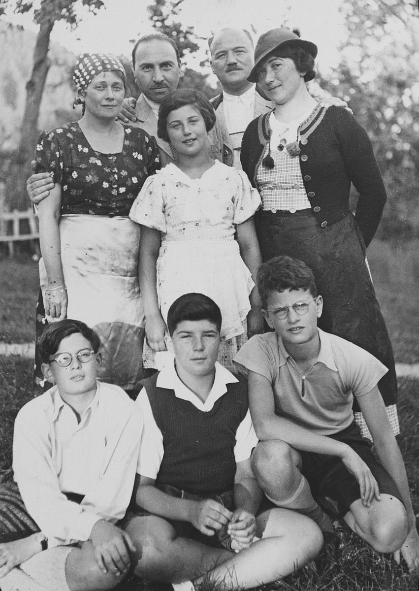 Group portrait of an extended Austrian-Jewish family.  Pictured sitting in the center is Herbert Popper.  Standing right to left are Olga, Julius and Susi Popper.