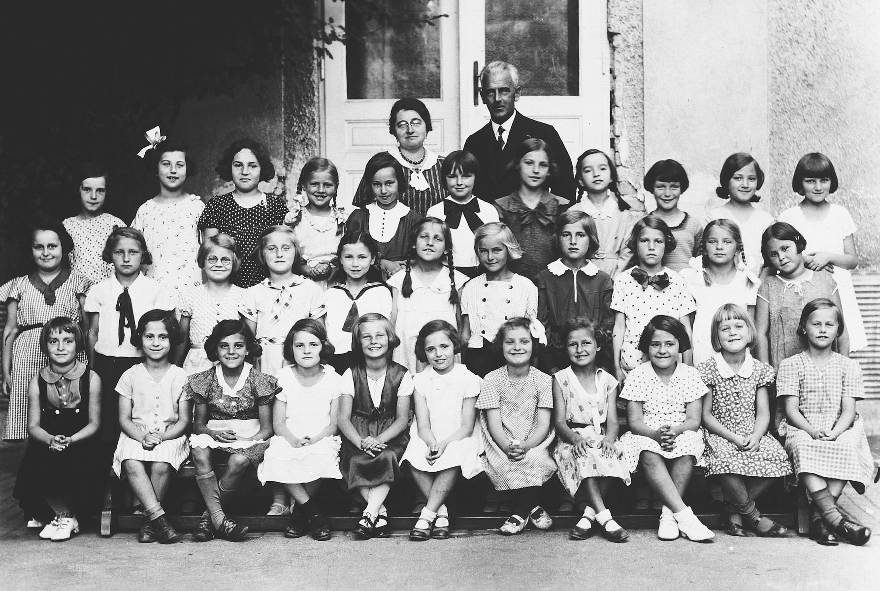 Group portrait of a class of both Christian and Jewish girls in an Austrian elementary school.  Susi Popper is pictured in the top row, third from right.