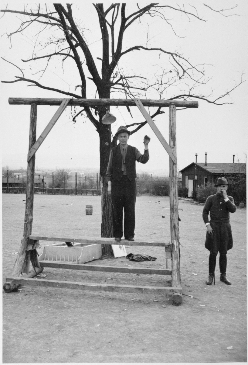 A survivor shows the gallows at Buchenwald  where a prisoner was hanged before all of the other inmates when he tried to escape.