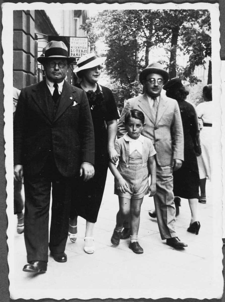 The Minerbi family walks down the streets of Warsaw.  Pictured from left to right: Arturo Minerbi, Fanny Ginzburg Minerbi, Sergio Minerbi and Leo Ginzburg (the brother of Fanny).