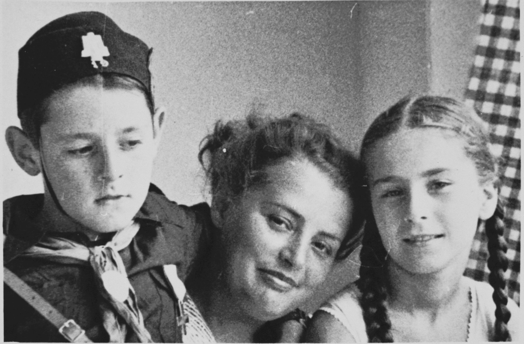 Close-up portrait of Sergio Minerbi, his mother Fanny and non-Jewish friend taken in the summer of 1938, on the eve of the Racial Laws.  Sergio Minerbi is wearing a Balilla uniform.