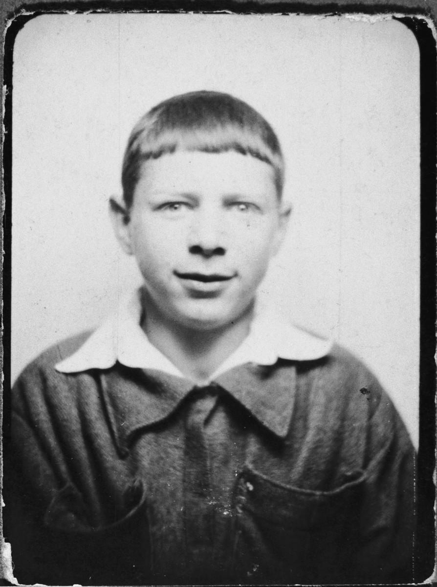 Passport photograph of Pawel Hochman (now Peretz Hochman) taken while he was living on the Aryan side of Warsaw.