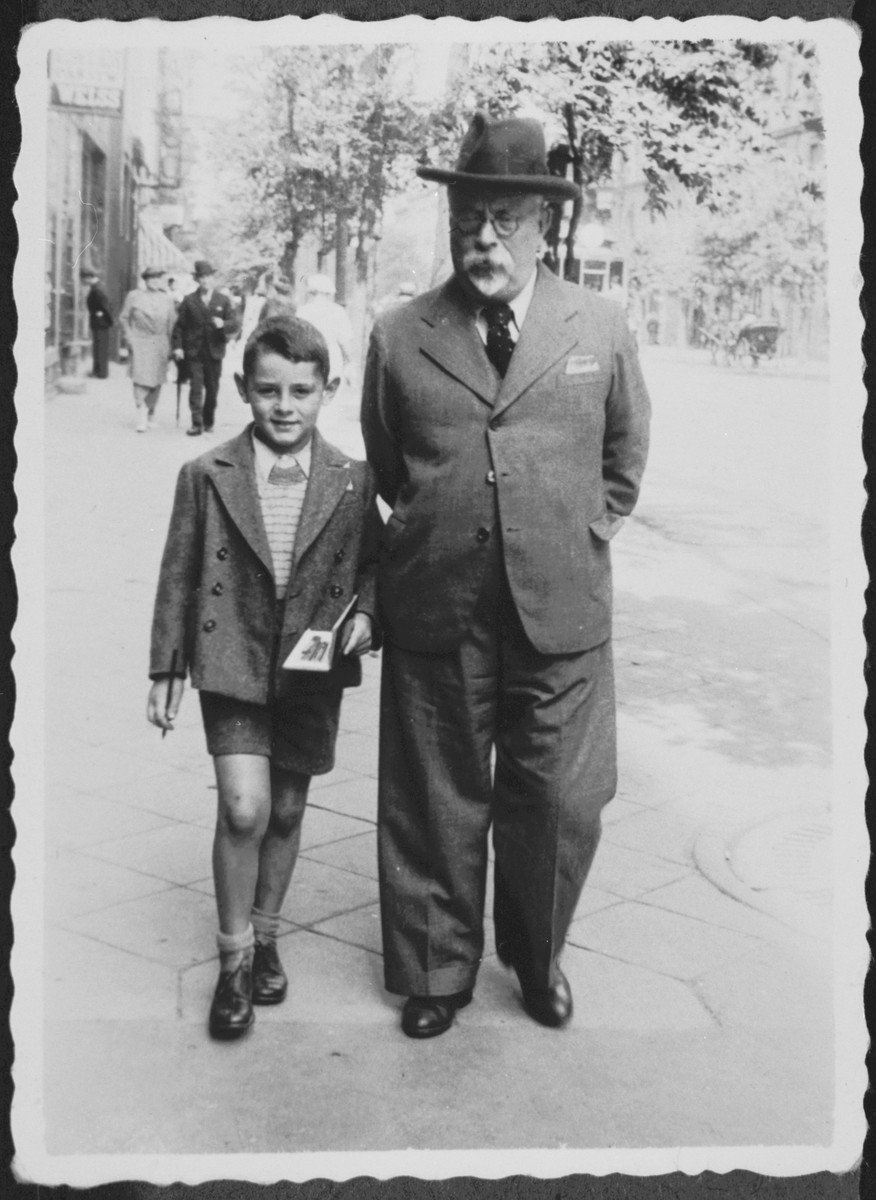 Sergio Minerbi walks down the streets of Warsaw with his Grandfather Chaim Benjamin Ginzburg.