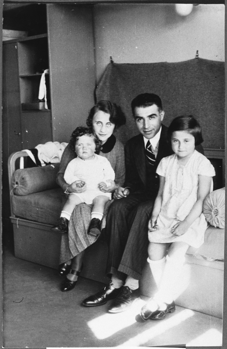 Photograph of the donor with her parents and younger sister before the war.