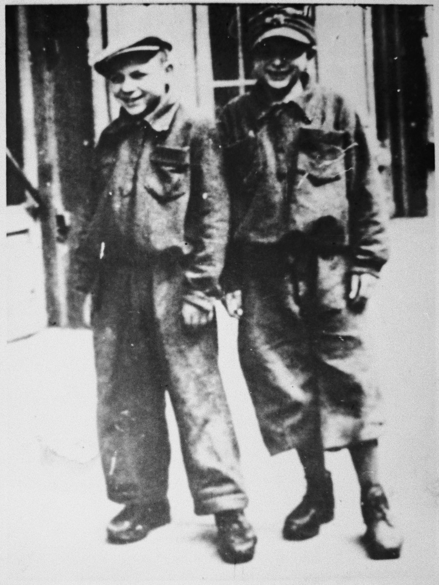 Close-up portrait of two young Jews living on the Aryan side of Warsaw and wearing suits made from German blankets.   Pictured is the donor and his brother Zenek.