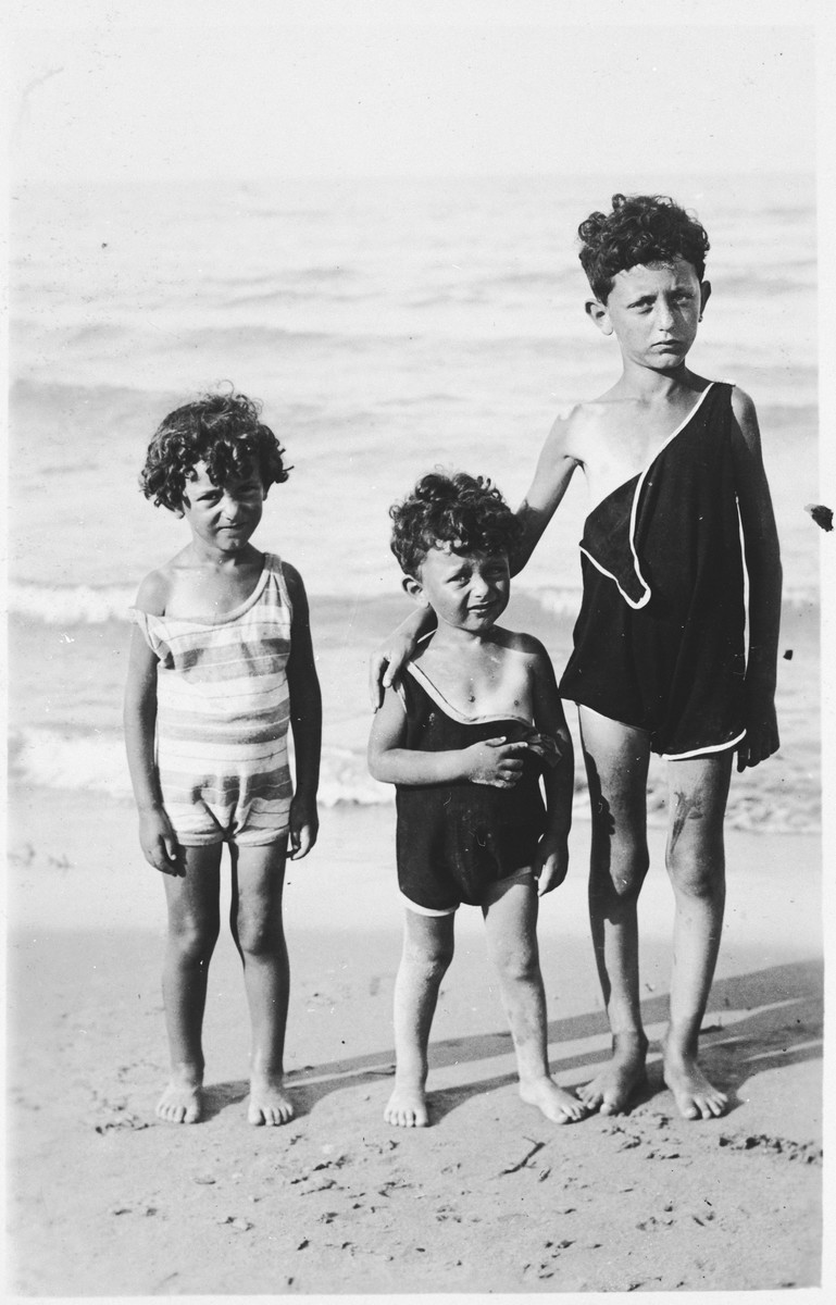 Sergio Minerbi's three cousins at the beach.  Pictured are (from left) Luisa, Giorgio-Lot, and Ruggero.  They are the children of Leo Minerbi.