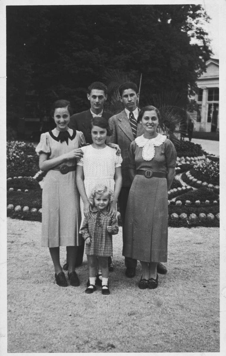 A Jewish family poses while on vacation at a spa in Slovenia.  Pictured in front is the donor, Stanka Weinrebe.  Behind her is her sister Mira.  Also pictured are their cousins Mima, Erna and Vlado Benedik and another unidentified Italian cousin.  All survived the war.