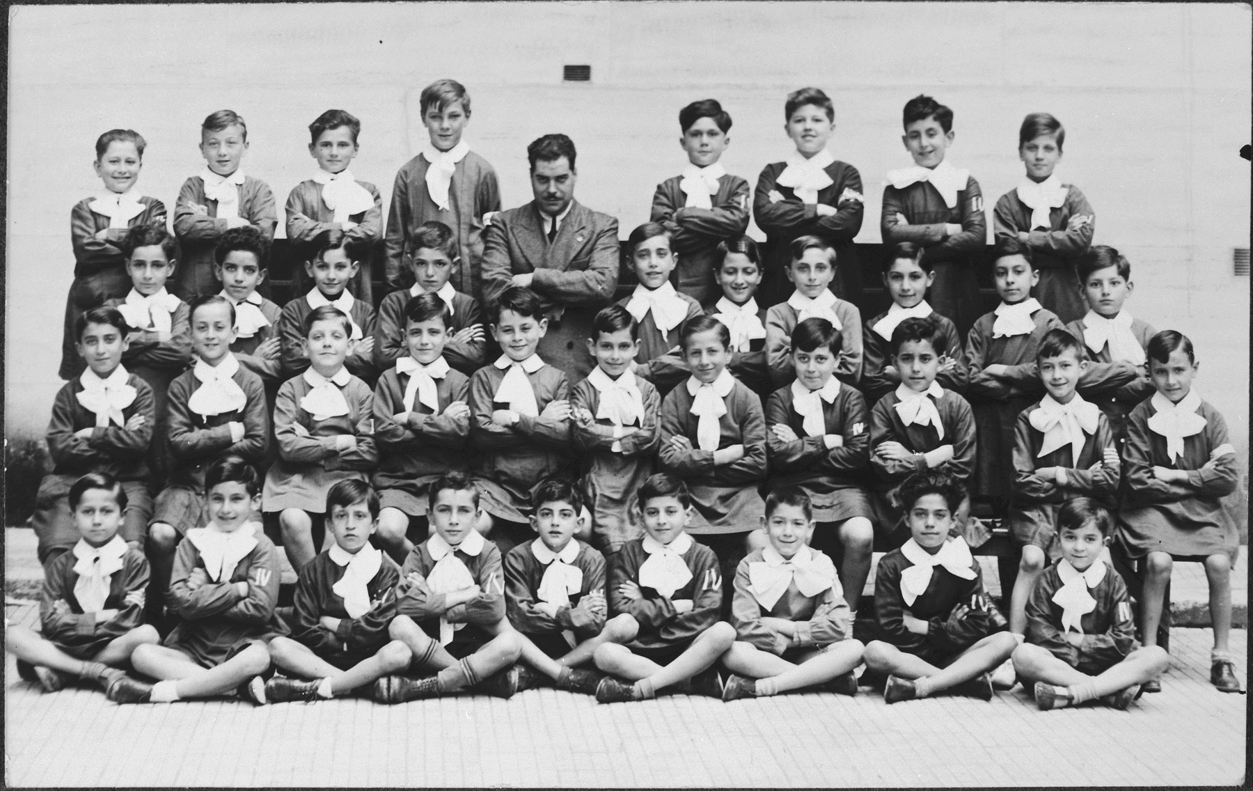 "Group portrait of the students of the last year at ""Enrico Corradini.""    Sergio is pictured in the second row from the bottom, and fifth from the left.  He is in front of teacher Pastina."