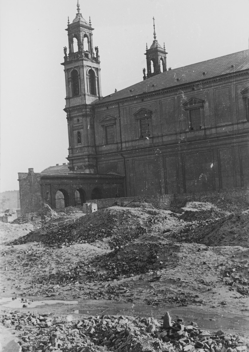 View of All Saints Church amid the ruins of the destroyed Warsaw ghetto.