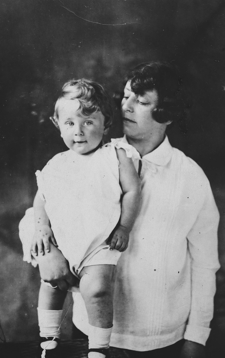 Studio portrait of a Polish-Jewish mother and her young son.  Pictured are Chaya Lau and her son Naphtali.