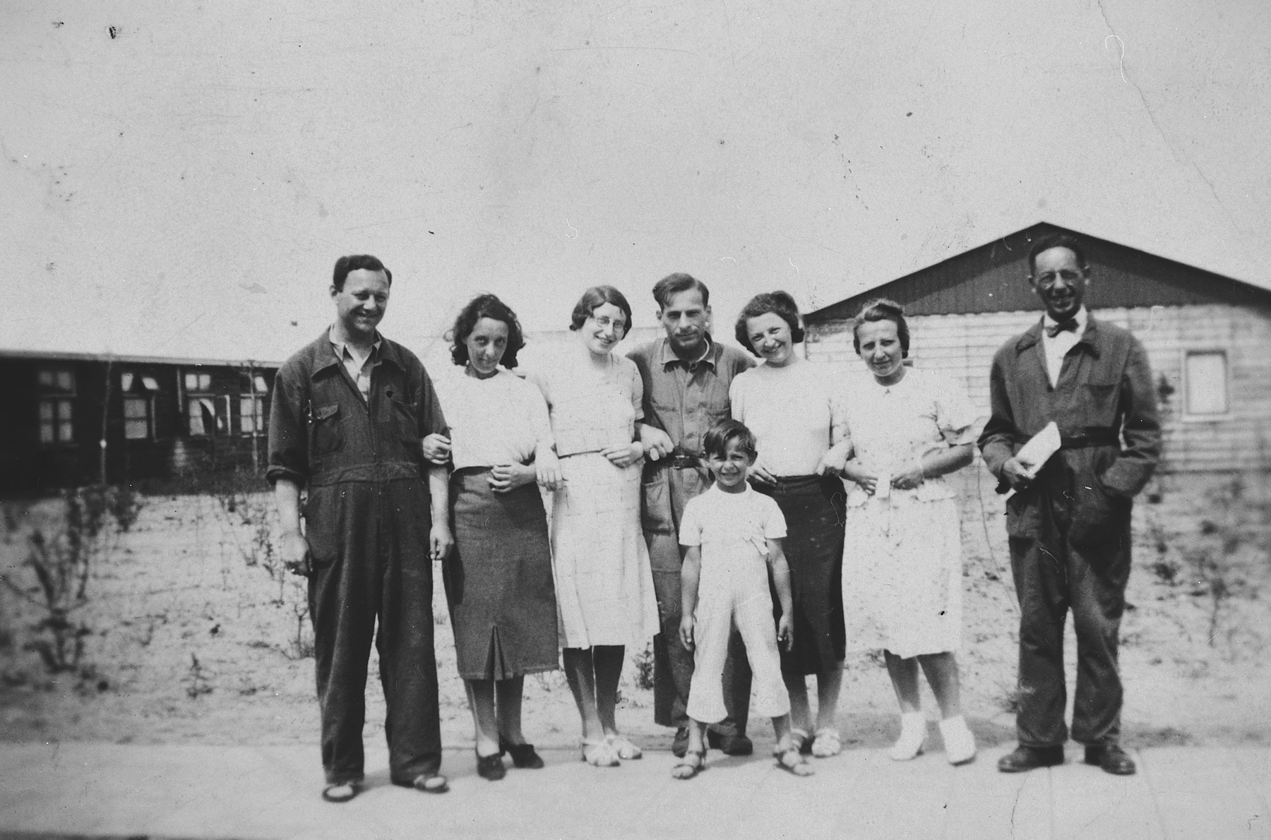 German-Jewish refugees pose outside one of the barracks of the Westerbork camp.  Among those pictured are Herta and Manfred Fink and their son Michael.