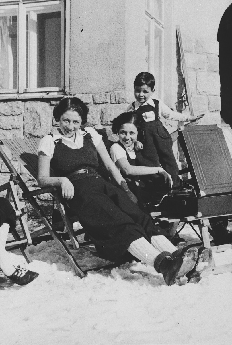 Two German-Jewish women and a child relax outside and listen to a phonograph.  Pictured on the left is Herta Fink.