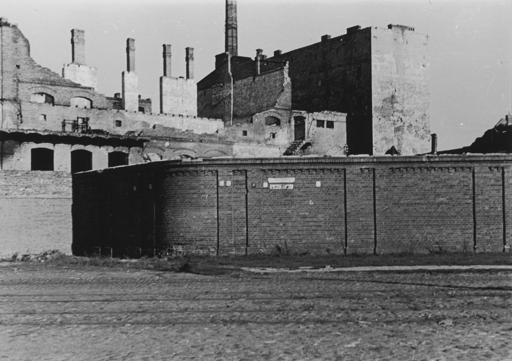 View of the wall surrounding the ruins of the Warsaw ghetto a few months after the ghetto's destruction.