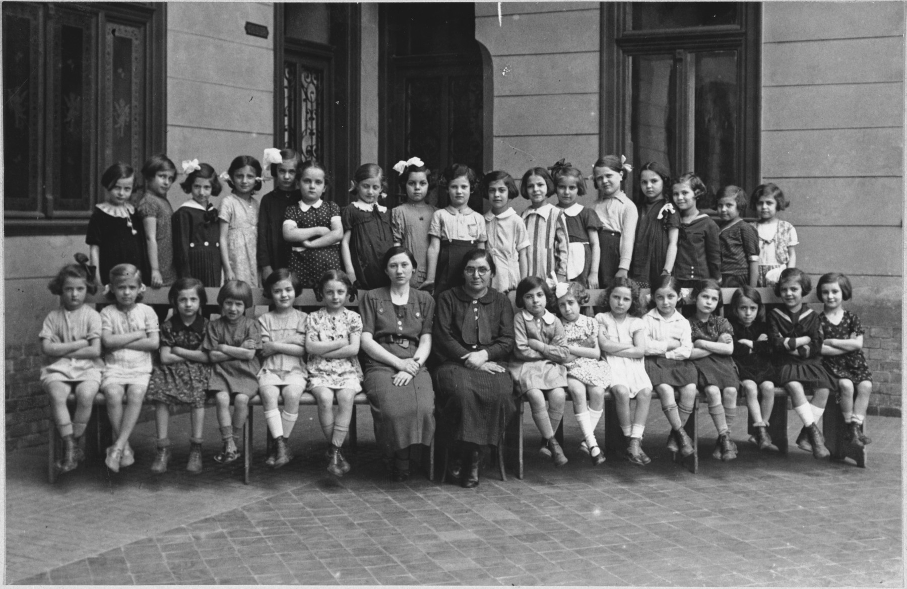 Group portrait of an elementary school class of an Orthodox Jewish school in Budapest, which met in the Kazinczy Street Synagogue.  Among those pictured is Anna Roz.