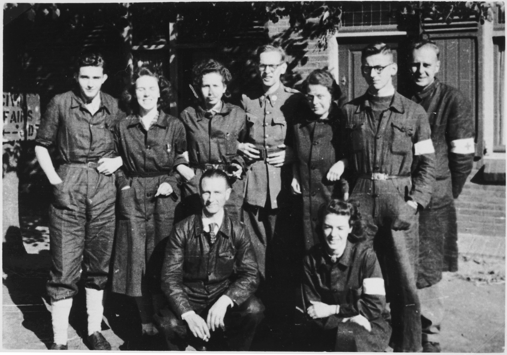 Group portrait of Red Cross workers in the newly liberated Bergen-Belsen concentration camp.