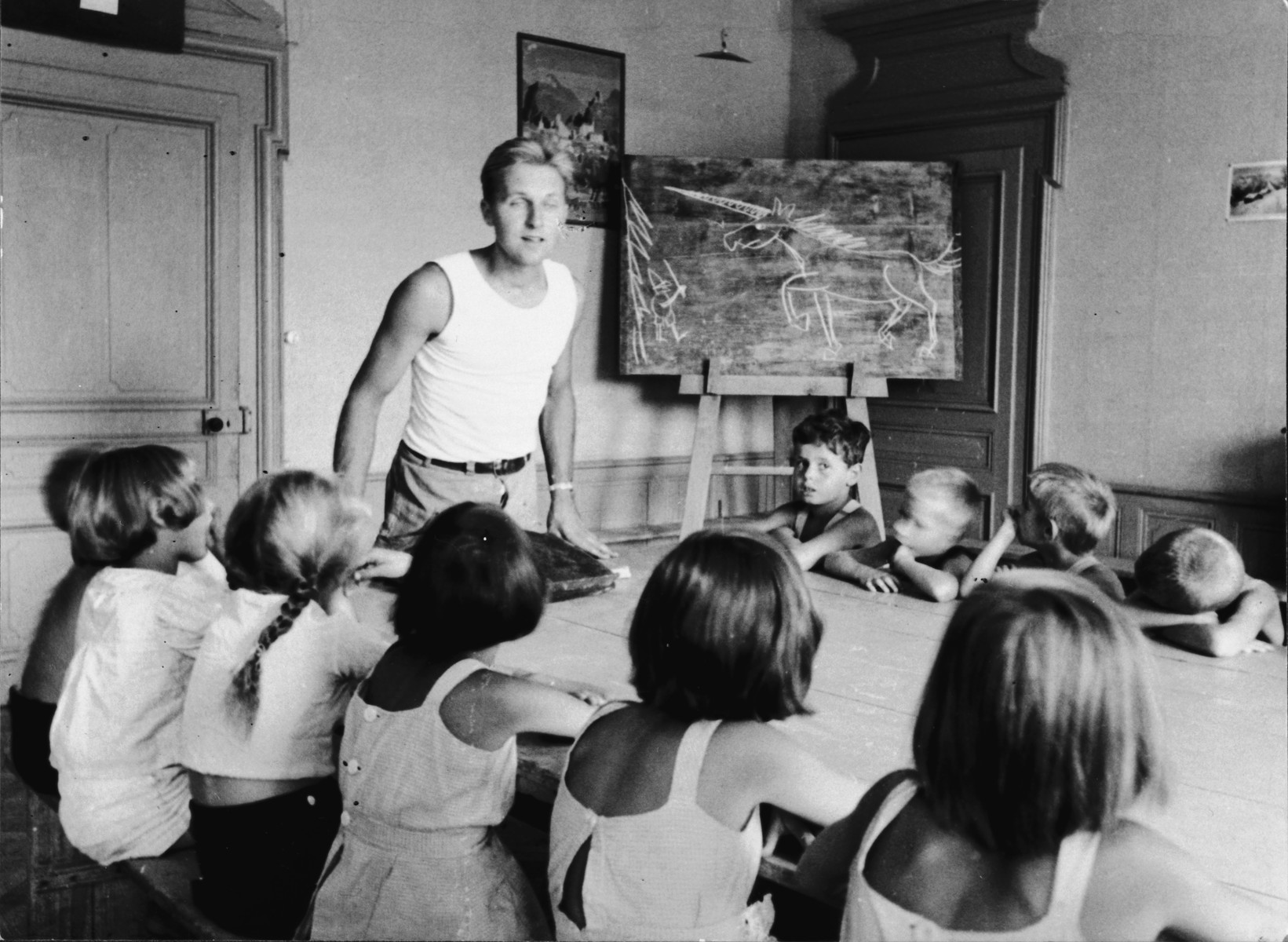 Fritz Amman teaches a class in the Pringy children's home, operated by the Swiss Red Cross.