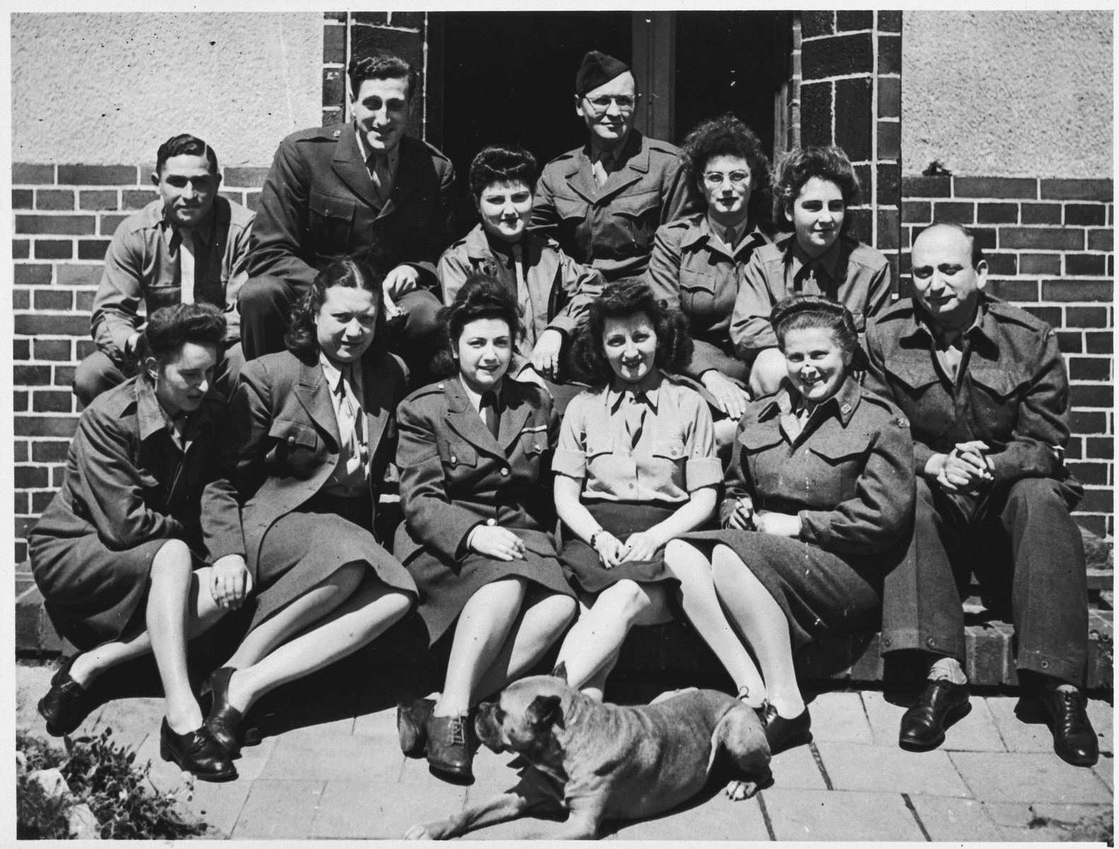 Group portrait of Joint Distribution aid workers in the Bergen-Belsen displaced persons' camp.  Among those pictured is Hilde Jacobsthal (second row, third from the right) and Dr. Spanier (far right).  Also pictured are Dr. and Rabbi Shalome Michael Gelber  (back row, second from the left) and Ms. Lottie Levinson, a Canadian from Vancouver (seated first row, second from the left)