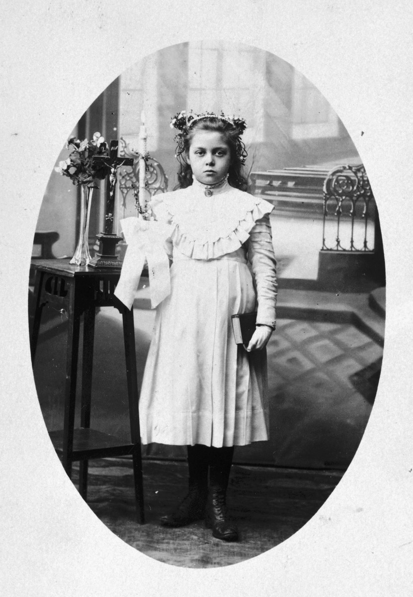 Prewar communion picture which was brought with the donor's family  to Rivesaltes and which ended up saving them from deportation.  Originally the entire family was slated for deportation, but just as they were about to board the train, the donor's mother showed the officials her childhood communion photo proving that she was not Jewish.  Her two daughters were also pulled from the transport.  Unfortunately, her Jewish husband was not spared.  He was transported to Drancy and from there to Auschwitz where he perished.