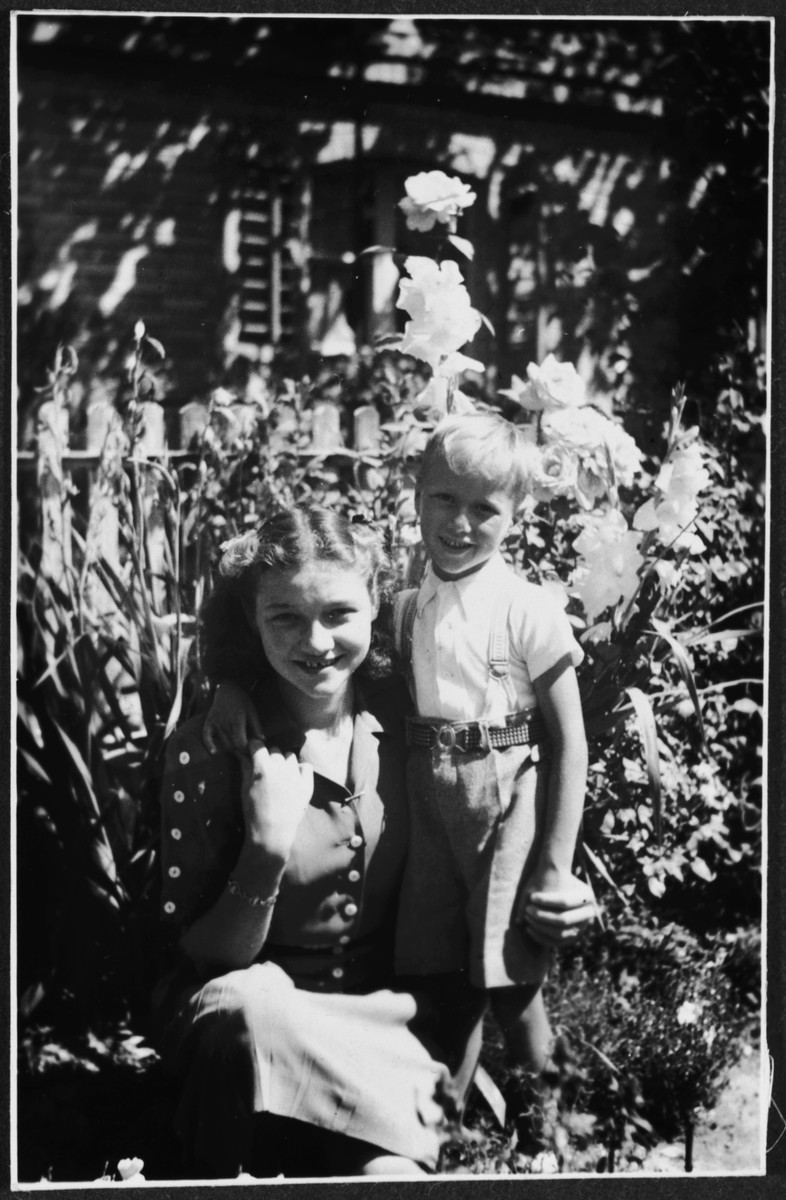 A half-Jewish refugee in Switzerland poses with the grandson of her hosts.  Pictured are Margot Schwarzschild and Hansueli Jost.  She was invited to Switzerland by her Swiss teacher, Hanni Jost.