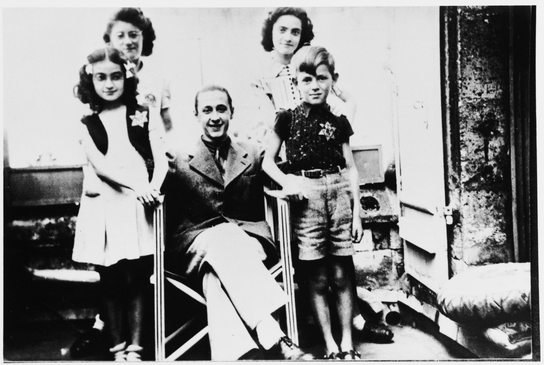 Group portrait of French Jewish children wearing a Jewish star.  Among those pictured are Paulette and Ruth Apfel and Roger Vinnitsky.