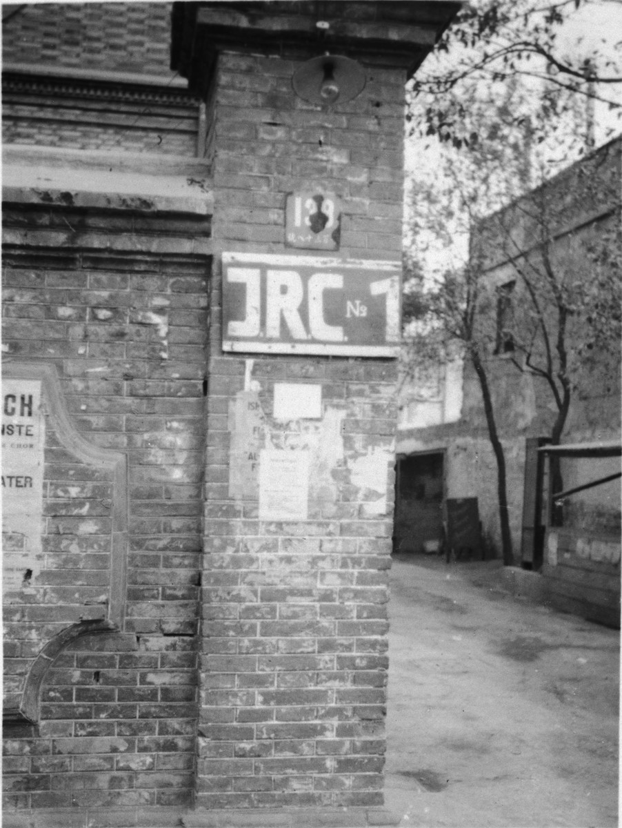 View of the exterior of a brick building painted with the initials IRC outside a heim on Ward Road in Shanghai.