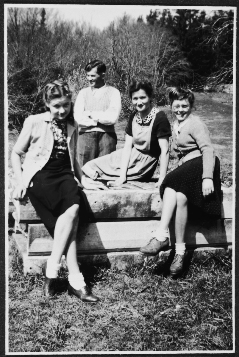 Staff and teachers of the Chateau des Avenieres children's home in Cruseiles pose outside on a wooden platform.  Among those pictured is Margot Schwarzschild (left).