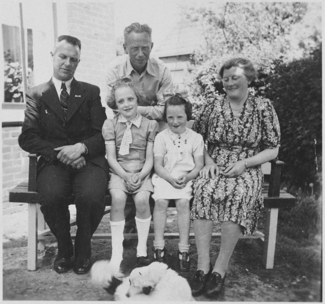 A Jewish father reunites with his daughter at the home of her rescuers shortly after the end of the war.    Seated from left to right are Dirk Hellinga, Janny Sluimer, Meip van Engel and Sjoukje Hellinga. Bernard van Engel is standing behind them.