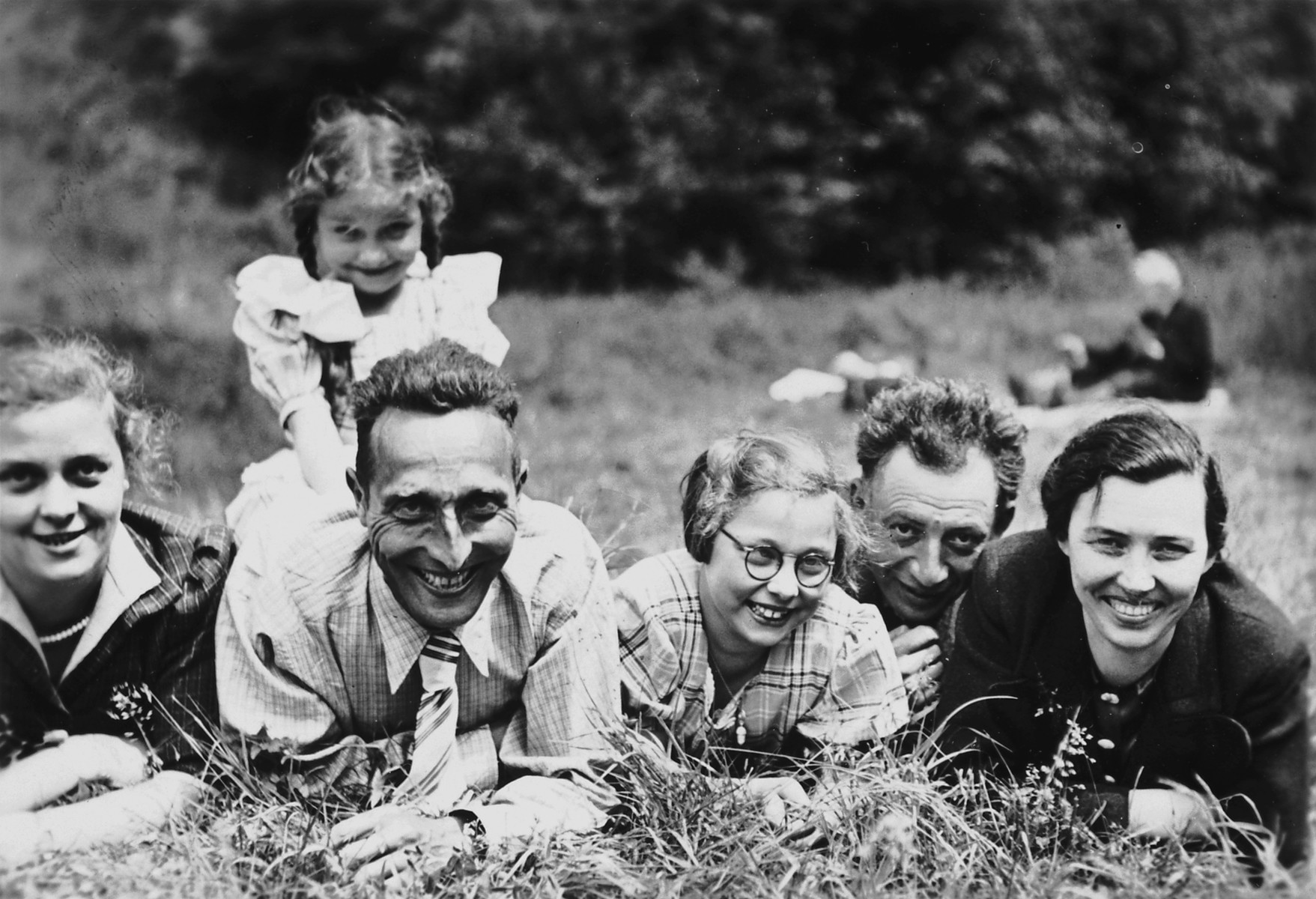 An intermarried German-Jewish family poses for a pictures while on a Sunday walk in the woods with Jewish friends.  Pictured on the left are Margot, Aloisia, Richard and Hannelore Schwarzschild.